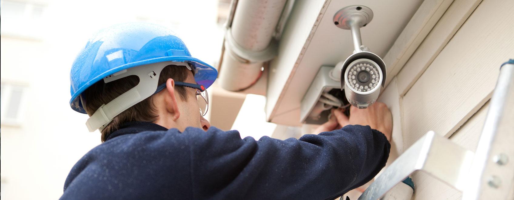 Technician installing security camera