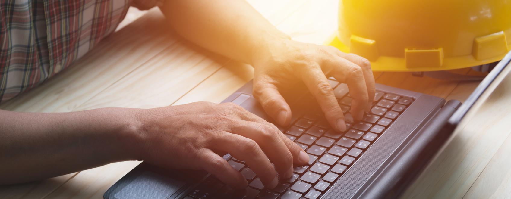 closeup of hands on laptop keyboard