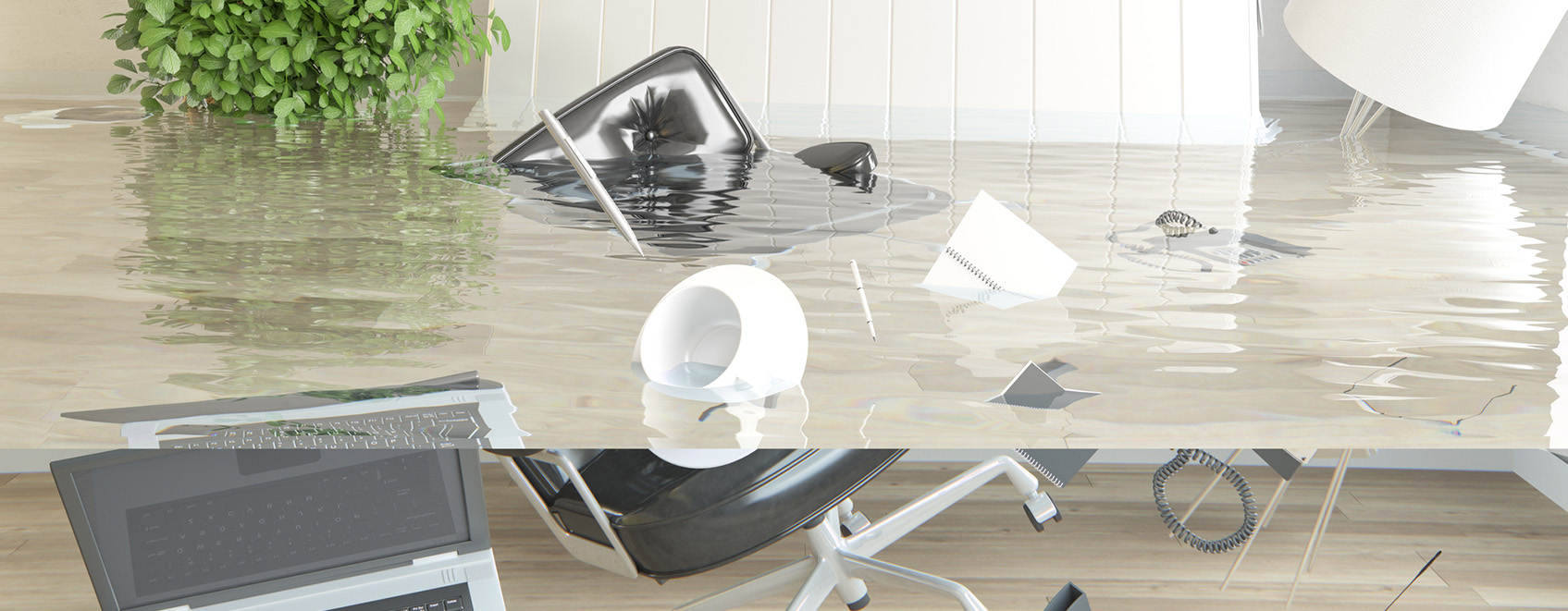 a flooded office, with furniture floating in the water