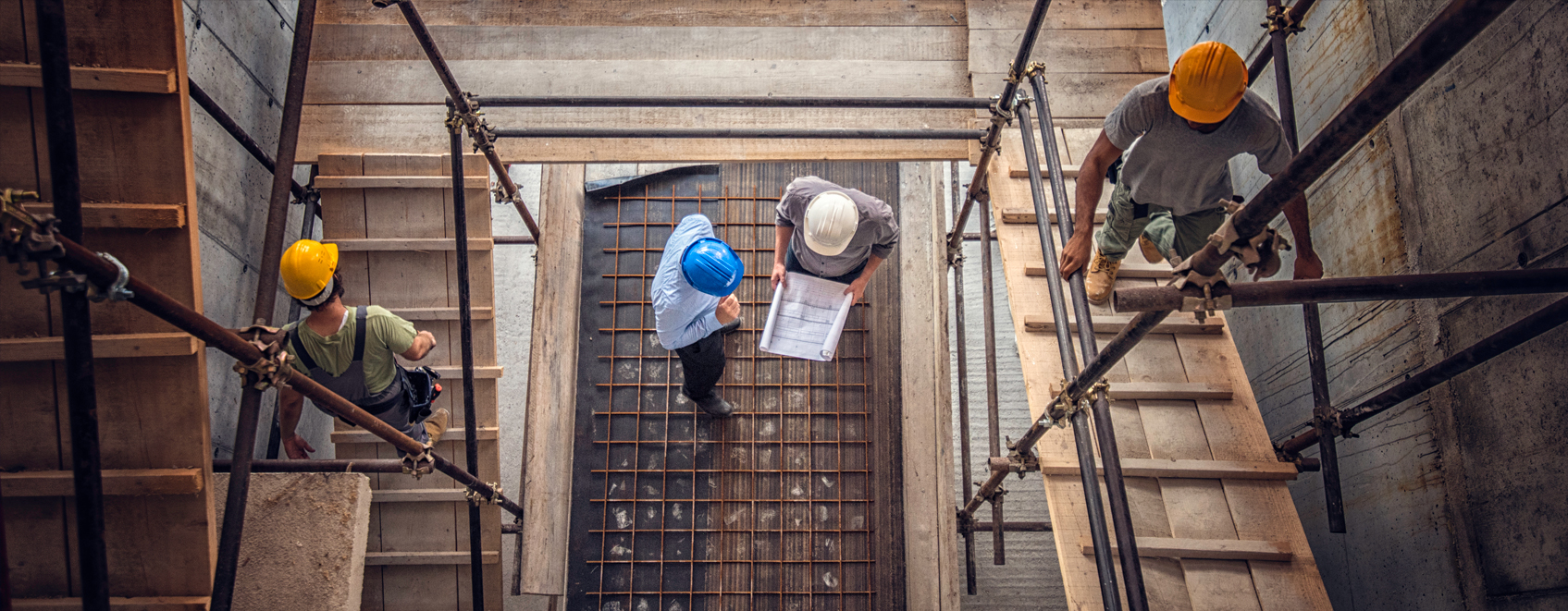 overhead view of construction professionals, talking together on a construction site