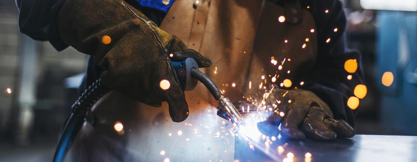 Closeup of metalworker's hands welding