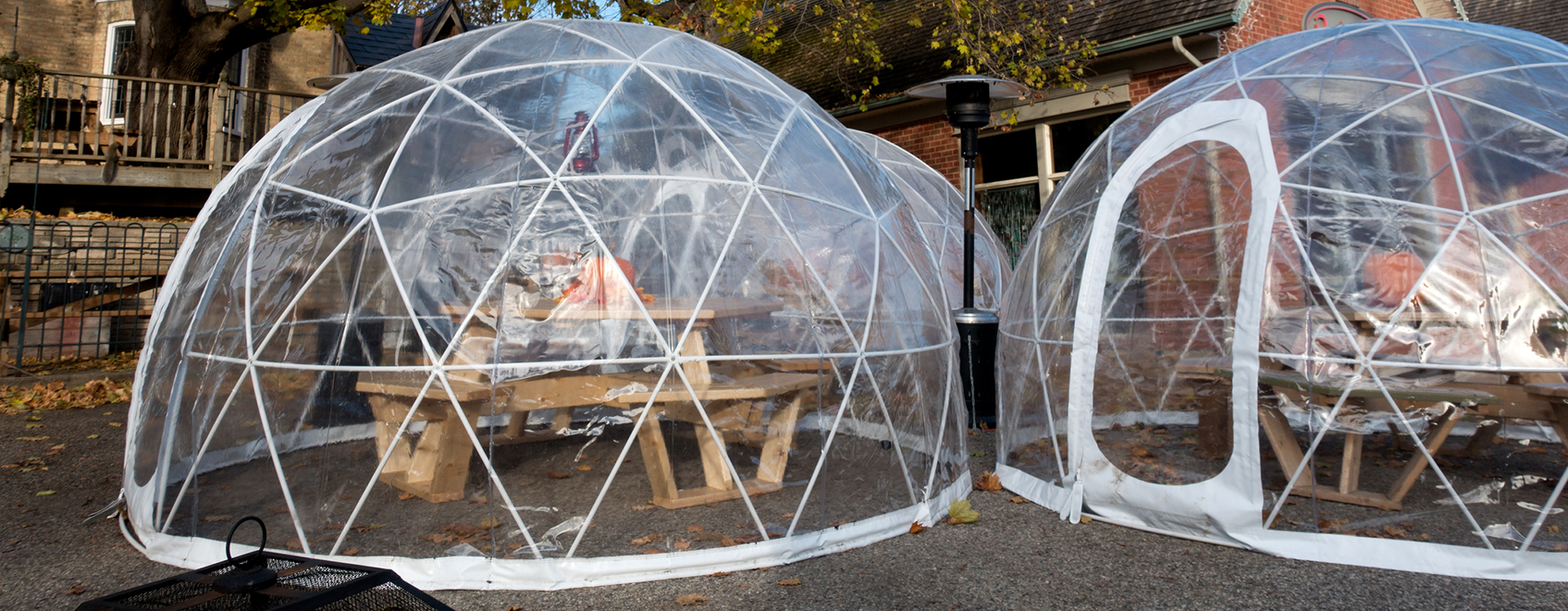 Outdoor dining tables, with clear bubble tents over them